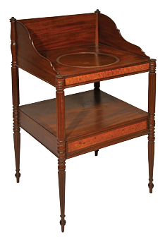 Fig. 5: Basin stand, Thomas Seymour (1771–1848), Boston, Mass., ca. 1812–1817. Mahogany, eastern white pine, cherry, with blistered maple veneer. Original hardware is missing; the cutout in the top for a basin has been filled in. H. 35, D. 21-1/2, W. 21-1/2 in. Photography by Robert D. Mussey Jr..