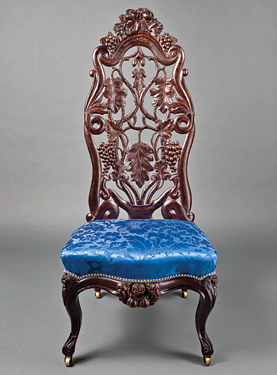 Fig. 3: Slipper chair designed and manufactured by John Henry Belter (1804–1863), New York, N.Y., ca. 1855. Laminated and carved rosewood, brass casters, reproduction silk damask upholstery. H. 43-3/4, W. 18-1/4, D. 20-1/4 in.