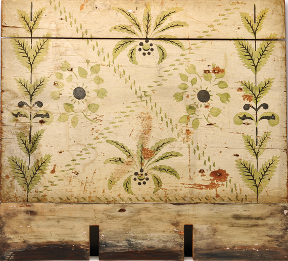 Fig. 3: Fireboard, ca. 1820. Stenciled stylized flowers and leaves on this fireboard create a bold pattern that could be visible anywhere in the parlor. (20.2.2).