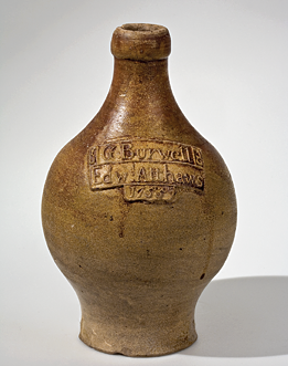 Fig. 2: Ale Bottle, attributed to the Sanders Pottery, Mortlake, England, 1755. Stoneware. H. 8-5/8 in. Courtesy, Colonial Williamsburg Foundation; gift in memory of Joseph Porter Moore by his wife, Adelia Peebles Moore (1976–128). Photograph by Craig McDougal, Colonial Williamsburg Foundation.