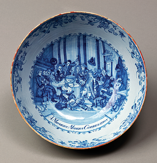 Fig. 1: Delftware punch bowl with William Hogarth's A Midnight Modern Conversation scene, probably Liverpool, England, 1750-1770. H: 6, Diam: 10-1/4 in. Winterthur museum purchase with funds provided by Mr. and Mrs. John Mayer and Mrs. Lammot du Pont Copeland (1984.30).