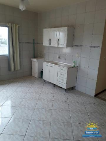 vista da entrada do apto cozinha