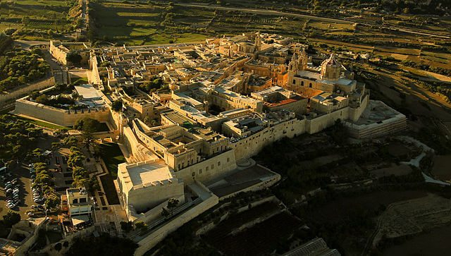 """Aerial view Mdina, Malta"" by R Muscat - Mdina. Licensed under CC BY-SA 2.0 via Wikimedia Commons - https://commons.wikimedia.org/wiki/File:Aerial_view_Mdina,_Malta.jpg#/media/File:Aerial_view_Mdina,_Malta.jpg"