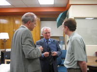 Dr. James Stathis (r) speaks with Prof. Christos Doumas (c) and Council General of Greece Dimitris Caramitsos-TsirasThe top photo shows Dr. James Stathis ( left) and Prof. Christos Doumas. Also attending were Consul General of Greece at Los Angeles, Dimit