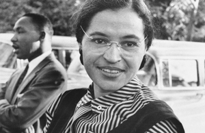 Rosa Parks, with Martin Luther King in the background