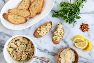 Lemony Artichoke White Bean Crostini with Shaved Parmesan