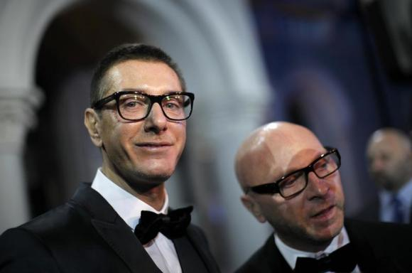 Italian designers Stefano Gabbana stands next to Domenico Dolce as they talk to the media during a party in Shanghai