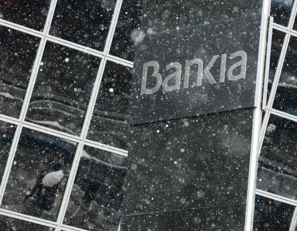 Snow falls at Bankia headquarters in Madrid
