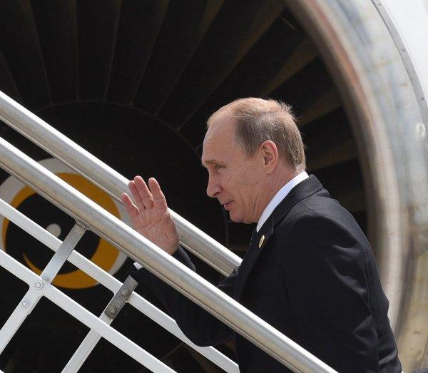 Putin Leave G20 11-16-2014
