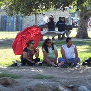 Balboa_park_-_red_umbrella_trio_card