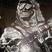 Pancake_mix_skeleton_playing_guitar_on_a_griddle_card
