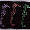 Triple_seahorses_merged_thumb