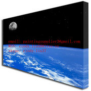 Blue_planet_moon_canvas_print_angled_card