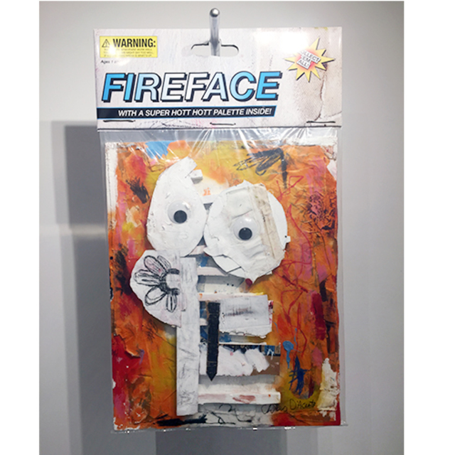 "Fireface, 2018, 40"" x 60"", 2018 Mixed media comprised of oil, spray-paint, pastel and acrylic paint on insulation foam, cardboard, paper and canvas encased in polystyrene plastic, with archival inkjet print and armature wire with conduit pipe. In verso: inkjet print on foam board."