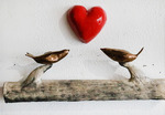 Desert_lovebirds_on_wooden_log
