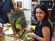 Carolina paints a Tucan