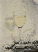 glass of white wine against snow