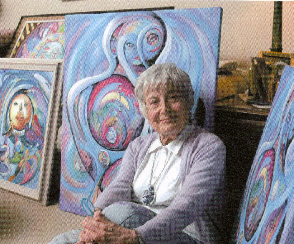 This is me, Doree, sitting among some of my acrylic paintings.
