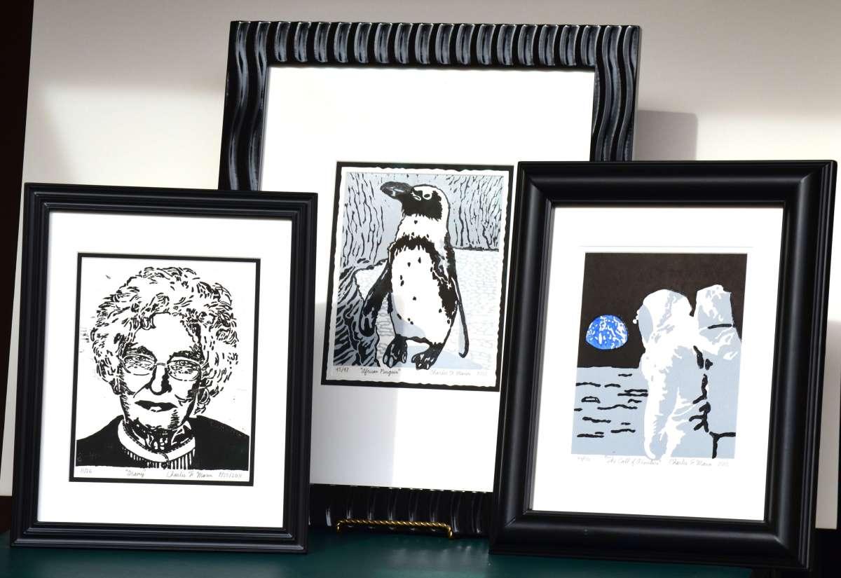 Three Mann Prints on a Table