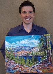 Photo pic of artist Nick Sninkelletti holding oil painting Desolation