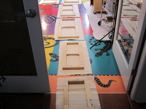 Canvases being stretched on studio floor