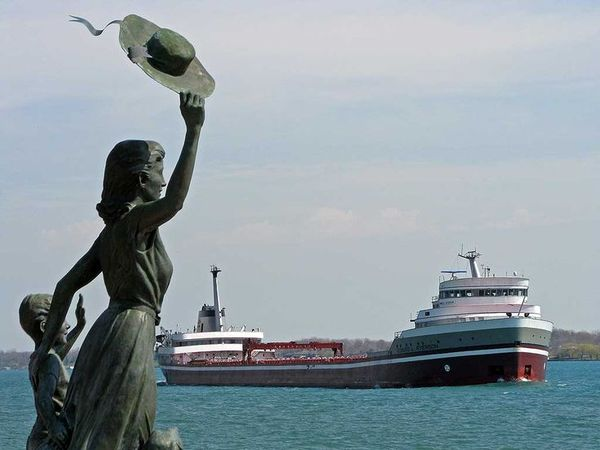 Lady waving at passing ships