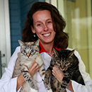 Dr. Small with two cats