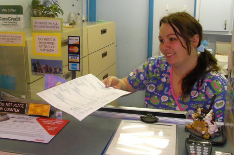 Rena working at the front desk