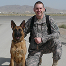 Major Rance P. Erwin at Kandahar, Afghanistan with a member of the K-9 corps.