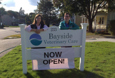 Dr. Trachtman & Dr. Klibaboff in front of the clinic sign.