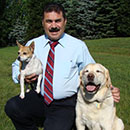 Nicholas L. Minervini with two dogs