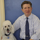 Dr. Handel and his standard poodle Louie