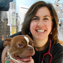 Dr. Vieira with a dog