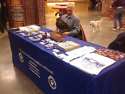 Dr. Anderson and dog Charlie at Iowa Energy Midcourt Mutts night