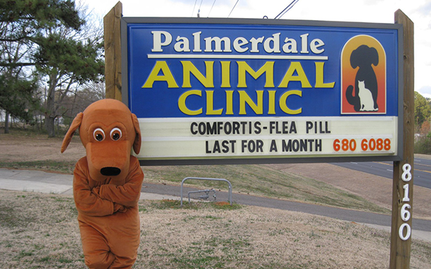 The sign outside of our veterinary clinic in Pinson AL and our mascot Palmer