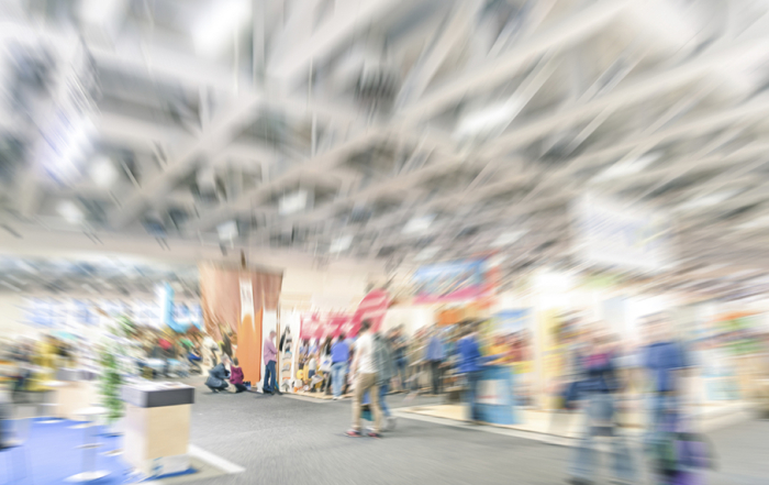 Generic trade show stand with blurred zoom defocusing - Concept