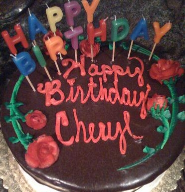 chocolate cake with the text 'Happy Birthday, Cheryl' written in frosting