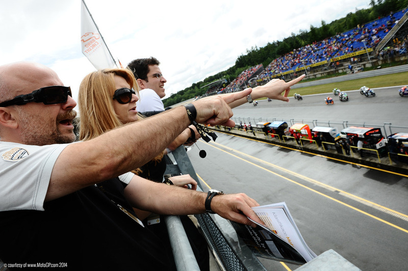 MotoGP-VIP-Village-World-Wide-Catalunya-Fans-on-Balcony-Watching-Brno-MotoGP-Race-QuintEvents