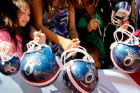 Nfl-on-location-pro-bowl-hawaii-ohana-day-kids-with-signed-helmets