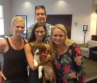 Miranda Lambert hands off the last of her foster pups to her new family.