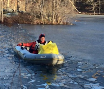 A 13-year-old boy and his dog were rescued from a small island where they were stranded.