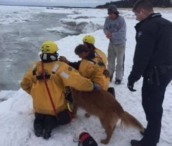 A woman and her dog were rescued from the frigid waters of Lake Superior on Wednesday.