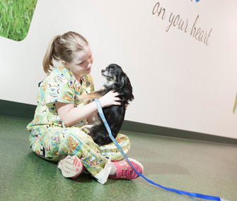 patient at a children's hospital with dog