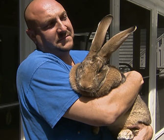 Joshua Lidsky holds his family's pet bunny, Sandy.