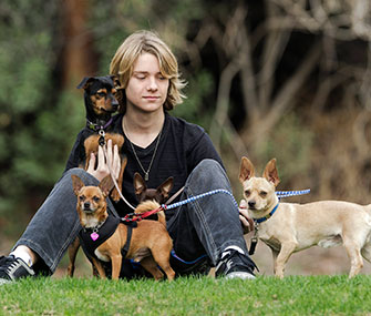 Actor Lou Wegner, 16, poses with his rescued dogs.