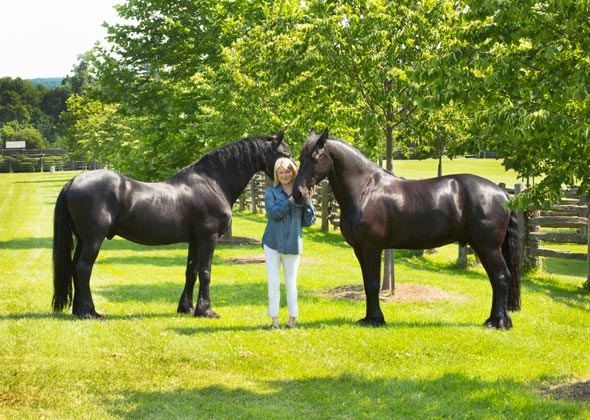 Martha Stewart poses with two horses