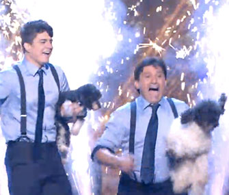 Nicholas and Richard Olate celebrate their America's Got Talent win with two of their dogs.