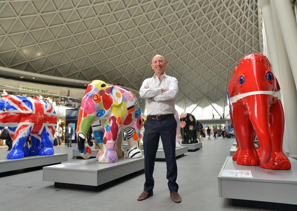 Elephant Parade founder with painted elephant statues