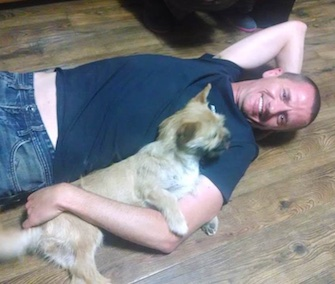 A Chinese stray was reunited Wednesday with the man from Scotland who plans to adopt her.