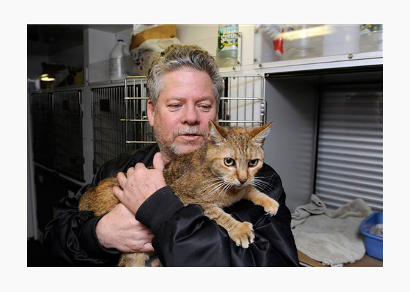 Cat and owner at shelter before Superstorm Sandy